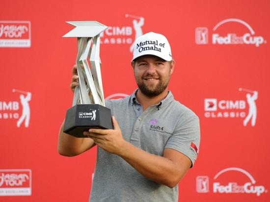 Ryan Moore with the CIMB Classic trophy ©eddieputera TCH