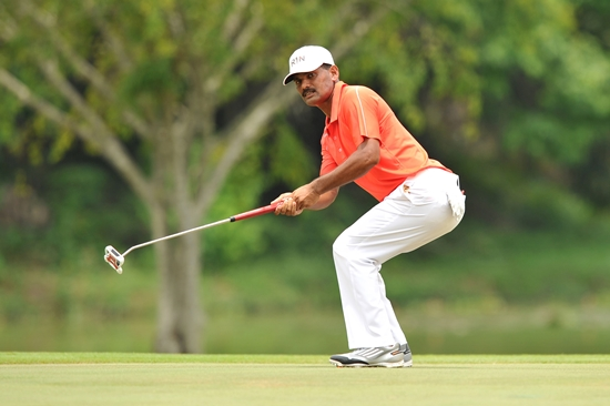 R. Nachimuthu looks on after rolling in a tricky birdie putt on the closing hole to cap a two-shot win ©Arep Kulal|PGM