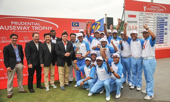 Team Malaysia pose for a photo with sponsor representatives at the conclusion of the Prudential Causeway Trophy ©David Ash|PMG