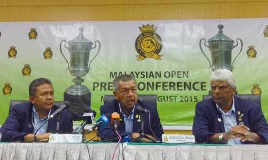 MGA president Admiral (R) Senator Tan Sri Dato Setia Mohd Anwar Mohd Nor answers a question from the media as honorary secretary Datuk Zulkifli Mohd Ismail (left) and honorary treasurer Bryan Andrew Perera (right) look on