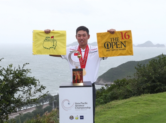 Cheng Jin of China holds the Masters and Open flag and poses with the Asia-Pacific Amateur Championship trophy ©Alex Liew AAC