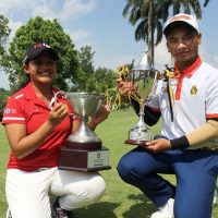 Siti Zulaikhaa (left) and Muhd Afif with their championship trophies
